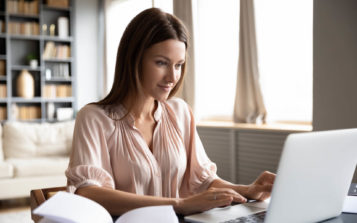 Woman Looking At Her HOA's Website